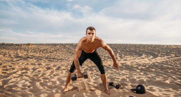 Sports Man training in sand